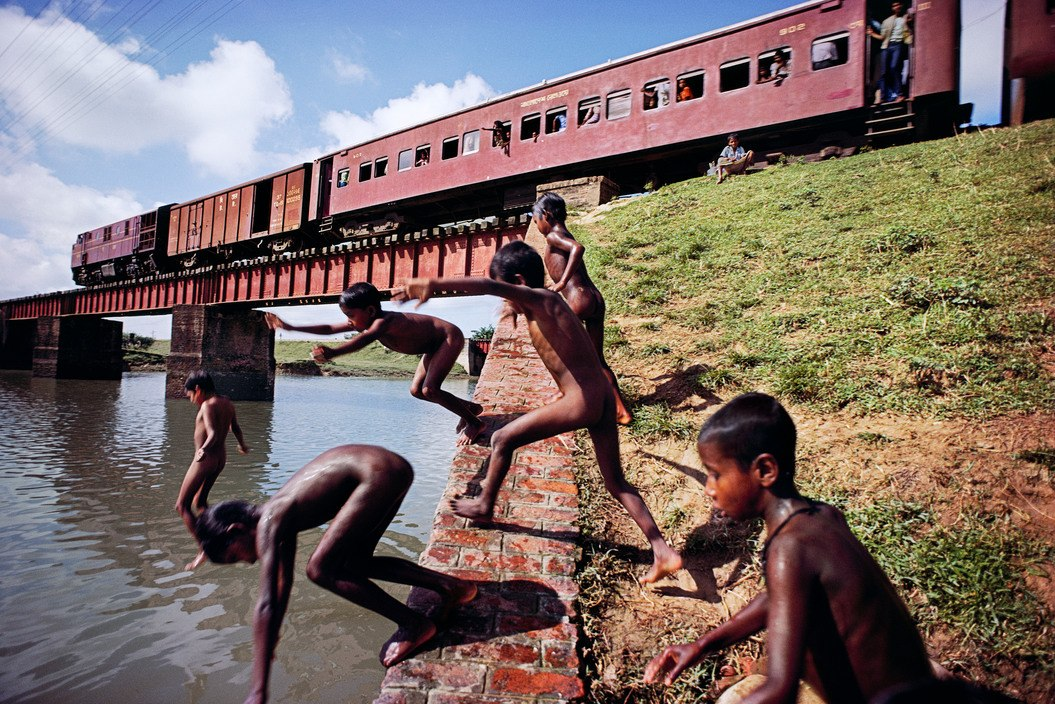 BANGLADESH. 1982. Children swim along the Dhaka-Chittagong rail line.