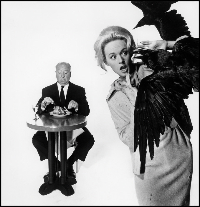 "USA. Tippi HEDREN, main actress in the movie ""The Birds"". In the background: British film director Alfred HITCHCOCK. 1962."
